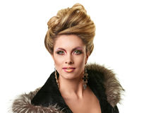 Portrait of elegant fashion woman. Glamour lady portrait in luxury fur coat. Beautiful model girl with fashion makeup and hairstyle Stock Images