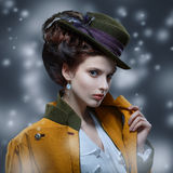 Portrait of elegant girl in a hat with a feather Royalty Free Stock Photography
