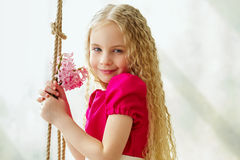 Portrait of an elegant girl with pink flowers Royalty Free Stock Photos