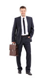 Portrait of an elegant handsome business man with  suitcase on w Royalty Free Stock Photos