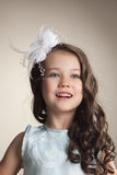 Portrait of elegant little girl posing in studio Stock Images