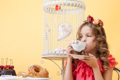 Portrait of elegant little lady drinking tea Stock Images
