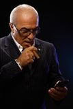 Portrait of elegant man with cigar and mobile Stock Images