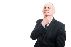 Portrait of elegant man holding his throat like hurting Royalty Free Stock Photo