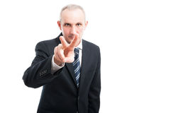 Portrait of elegant man showing watching you gesture Stock Photo