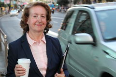 Portrait of an elegant mature female CEO in the city Royalty Free Stock Image