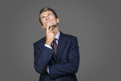 Portrait of elegant pensive businessman. Looks up looking for answers Royalty Free Stock Photos