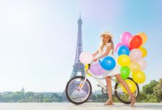 Frinch girl holding bicycle with colorful balloons Royalty Free Stock Photos
