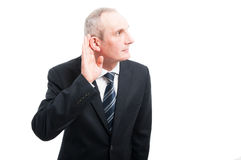 Portrait of elegant senior making can`t hear you gesture Royalty Free Stock Images