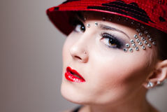 Elegant pretty lady with red hat & lips, crystals makeup Stock Images