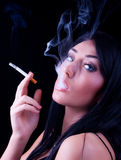 Portrait of elegant smoking brunette Stock Images