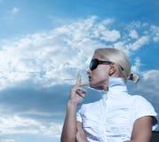 Portrait of elegant smoking woman Stock Photos