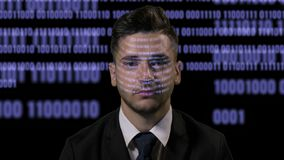 Portrait of an elegant software developer programmer working with data and blue projected computer codes on black background -. Portrait of an elegant software stock video