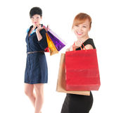 Portrait of elegant two women with shopping bags Royalty Free Stock Photography
