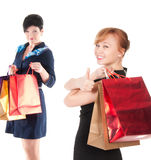 Portrait of elegant two women with shopping bags Stock Images