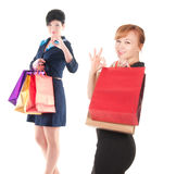 Portrait of elegant two women with shopping bags Stock Photos