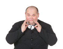 Portrait elegant very fat man in suit and bow Royalty Free Stock Images