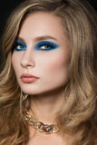 Portrait of elegant woman with beautiful blonde hair and modern. Close-up portrait of elegant woman with beautiful blonde hair and modern fashion make-up. Blue Stock Photos