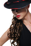 Portrait of elegant woman with black hat. Glamour portrait of cute elegant young girl with black hat Stock Photography