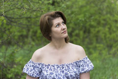 Portrait of an elegant woman in  dress with bare shoulders Royalty Free Stock Photography