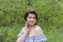 Portrait of an elegant woman in  dress with bare shoulders Stock Photo