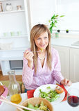 Portrait of an elegant woman eating a salad Royalty Free Stock Photo