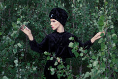 Portrait of elegant woman in the forest Royalty Free Stock Image