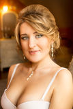 Portrait of elegant woman with green eyes in bra posing at hotel Stock Image