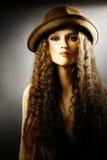 Portrait of elegant woman in hat. Fashion model in headwear Royalty Free Stock Photography