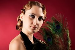 Portrait of elegant woman holding feather Stock Photo
