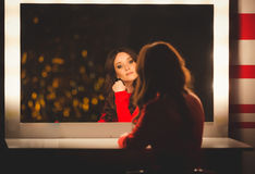Portrait of elegant woman posing at table with big mirror Stock Photo