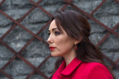 Portrait of an elegant woman in a red coat Royalty Free Stock Images