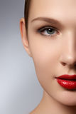 Portrait of elegant woman with red lips. Beautiful young model w Stock Photography