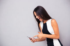Portrait of elegant woman screaming on smartphone Stock Images