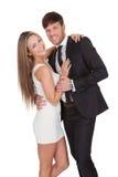Portrait of elegant young couple. Isolated on white Stock Photos