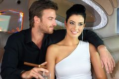 Portrait of elegant young couple smiling stock image