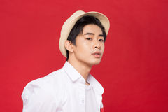 Portrait of elegant young handsome asian man with hat. Cool fash Stock Images