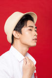 Portrait of elegant young handsome asian man with hat. Cool fash Stock Image