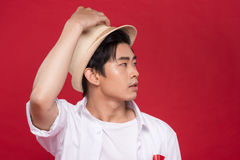 Portrait of elegant young handsome asian man with hat. Cool fash Stock Photo
