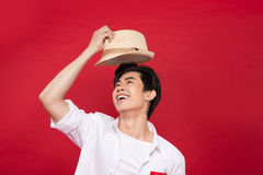 Portrait of elegant young handsome asian man with hat. Cool fash Royalty Free Stock Image
