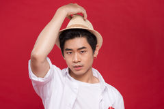 Portrait of elegant young handsome asian man with hat. Cool fash Stock Photos