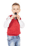 Portrait elegant young handsome joyful little kid singing on a b. Lack microphone isolated on white background Stock Photo