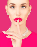 Portrait of an elegant young woman. On a pink background Stock Image