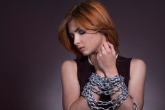 Portrait of a elegantly dressed young women chained Stock Photos