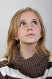 Portrait of a elementary girl looking up. Portrait of a elementary pretty girl looking up Royalty Free Stock Images