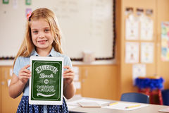 Portrait of elementary school girl holding a smart tablet Royalty Free Stock Photos
