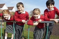 Portrait Of Elementary School Pupils On Climbing Equipment Royalty Free Stock Photos