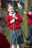 Portrait Of Elementary School Pupils On Climbing Equipment Stock Image