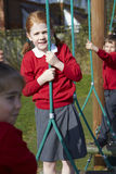 Portrait Of Elementary School Pupils On Climbing Equipment Royalty Free Stock Photography