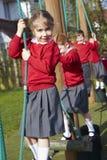 Portrait Of Elementary School Pupils On Climbing Equipment Stock Photo